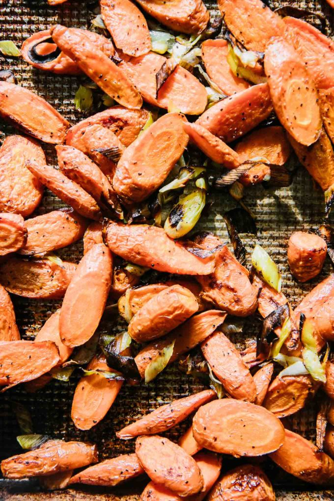 roasted carrots and leeks on a baking sheet
