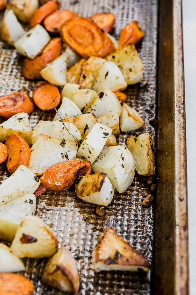 carrots and turnips on a sheet pan after roasting
