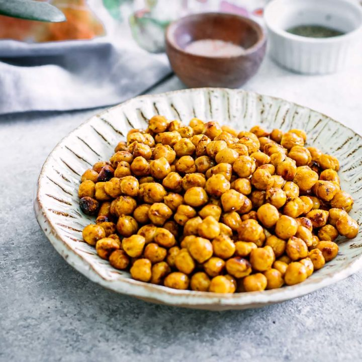 baked chickpeas in a bowl on a white table
