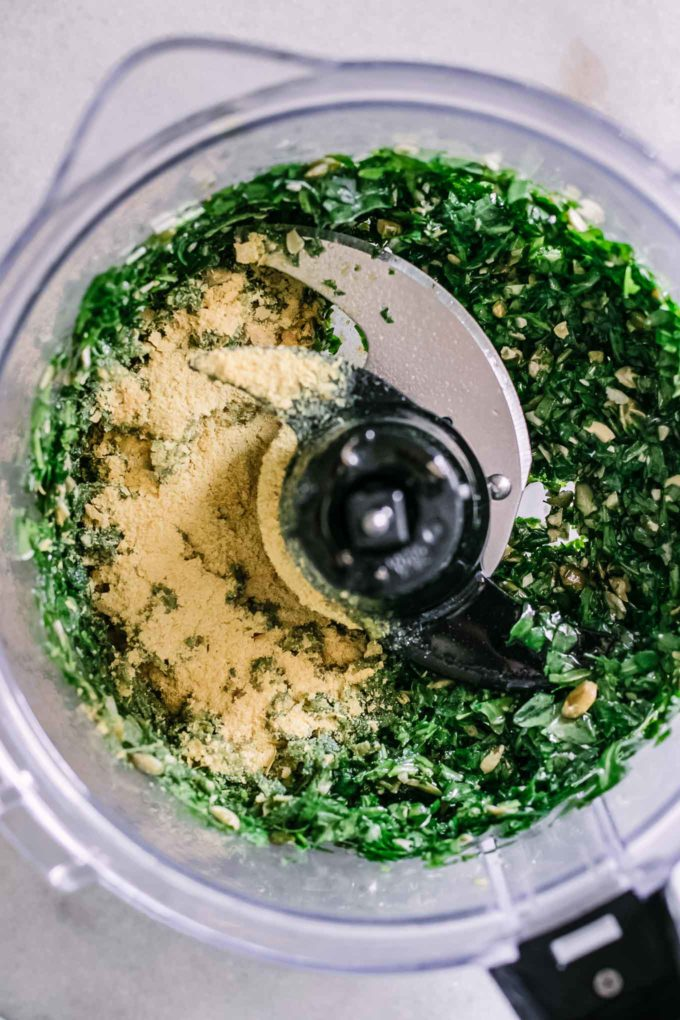 blended pesto with nutritional yeast inside a food processor