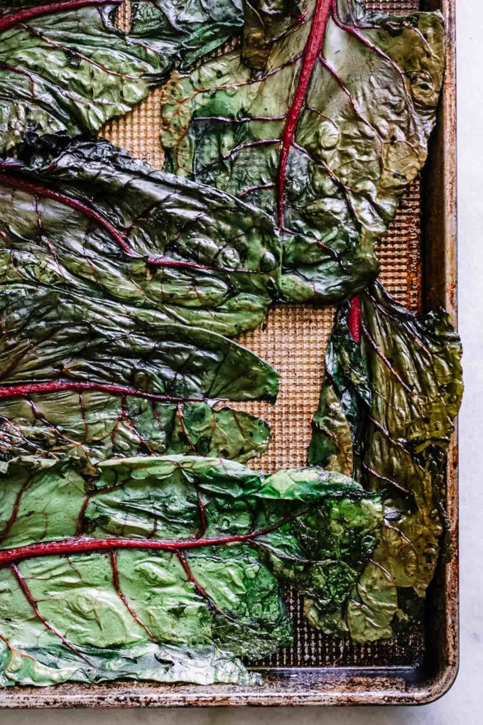 cooked chard leaves on a sheet pan