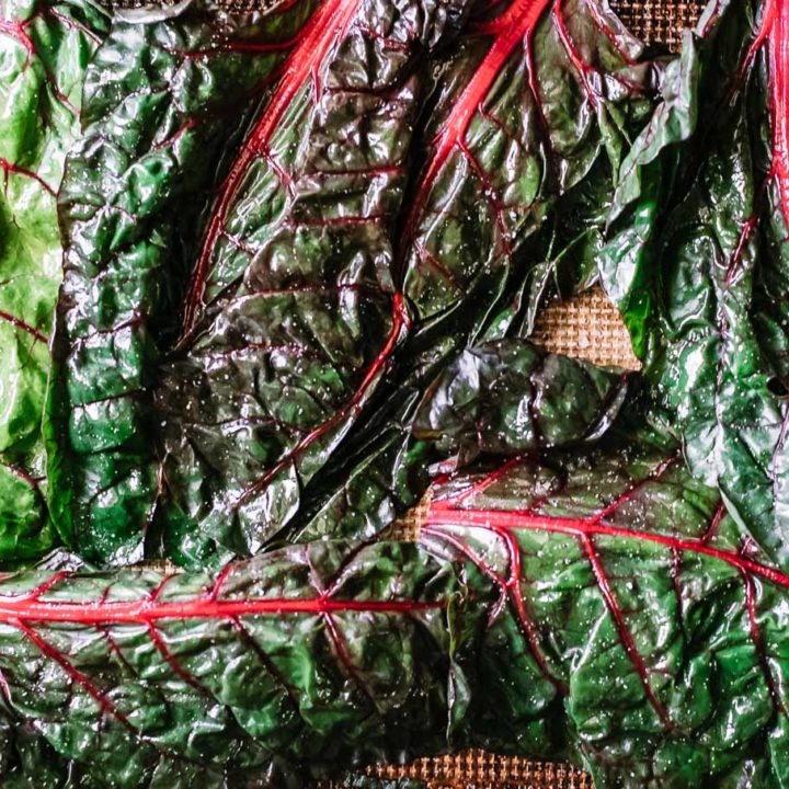chard leaves on a table with sprinkled salt