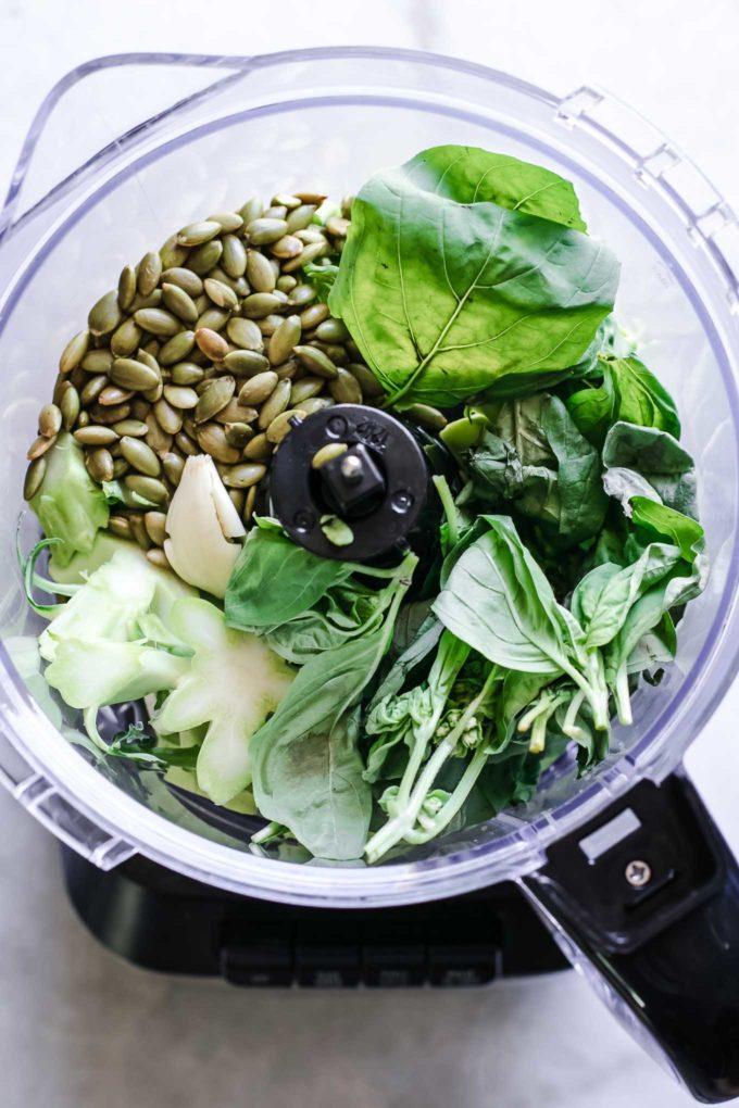 broccoli stems, basil, nuts, and garlic in a food processor
