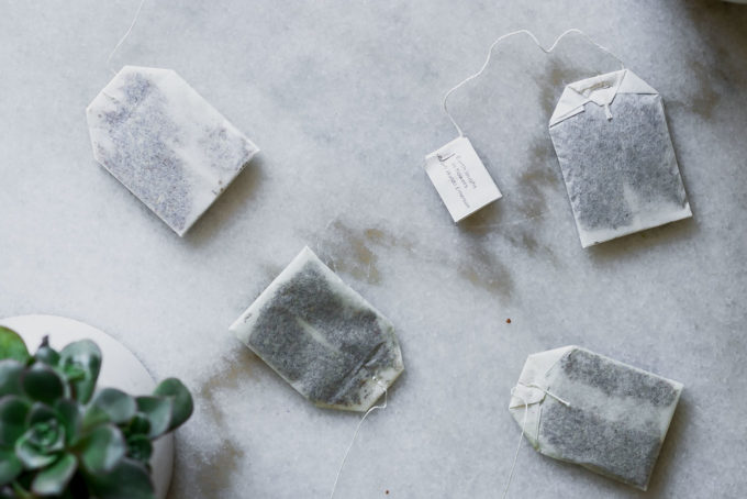 tea bags with strings on a marble countertop