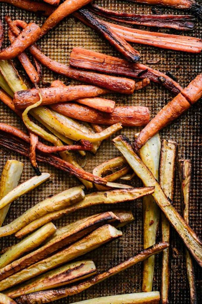 roasted parsnips and carrots on a sheet pan after baking