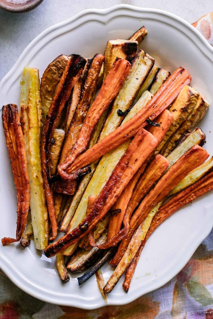 roasted carrots and parnsips on a white serving plate