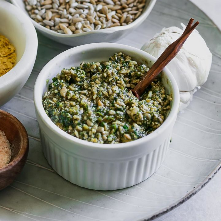 sunflower seed pesto in a white bowl