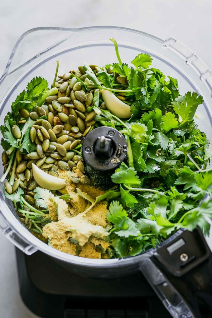 cilantro, garlic, seeds, nutritional yeast, and oil in a food processor