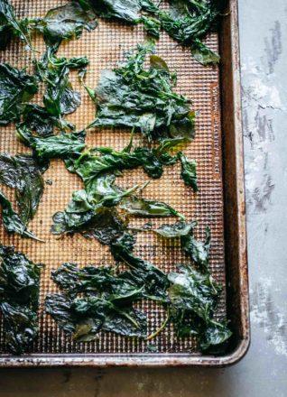 close up view of radish greens on a baking sheet