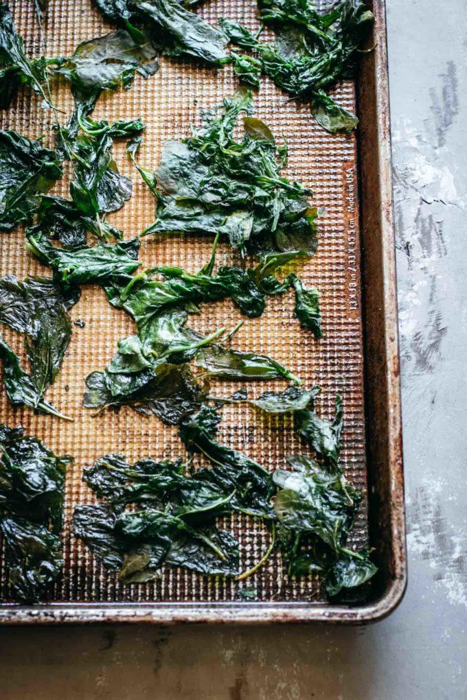 close up view of baked radish greens on a baking sheet