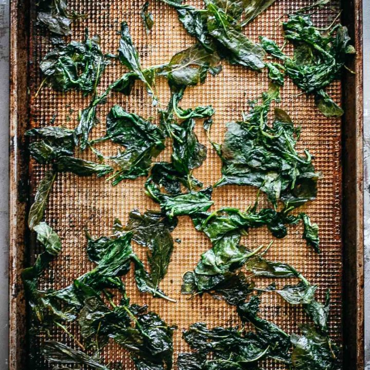 crispy radish greens on a baking pan