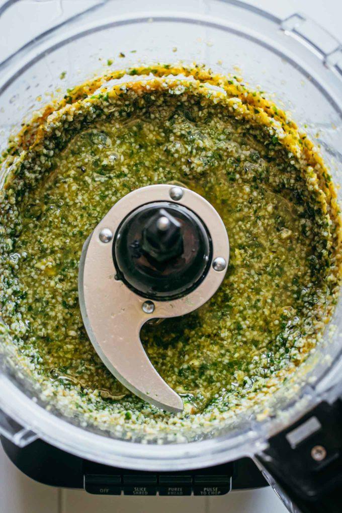 blended hemp seed pesto ingredients in food processor