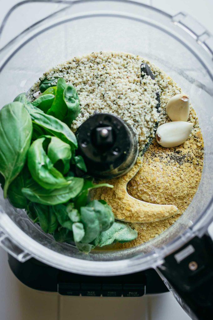 basil, hemp seeds, garlic, cheese, salt, and pepper in a food processor