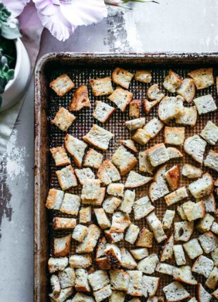 homemade rye bread croutons on a baking pan