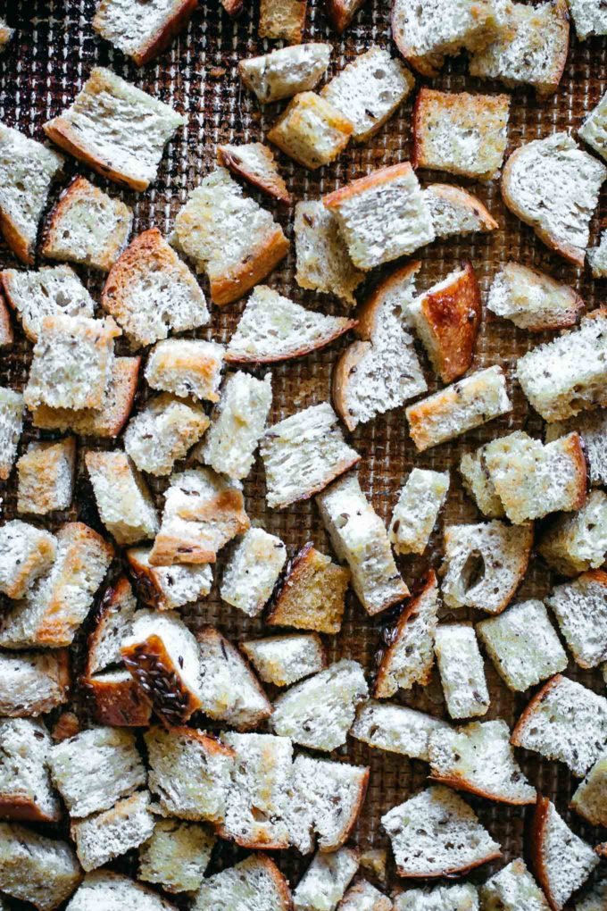 cooked rye croutons on a baking sheet
