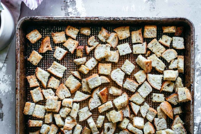 baked rye croutons on a baking sheet