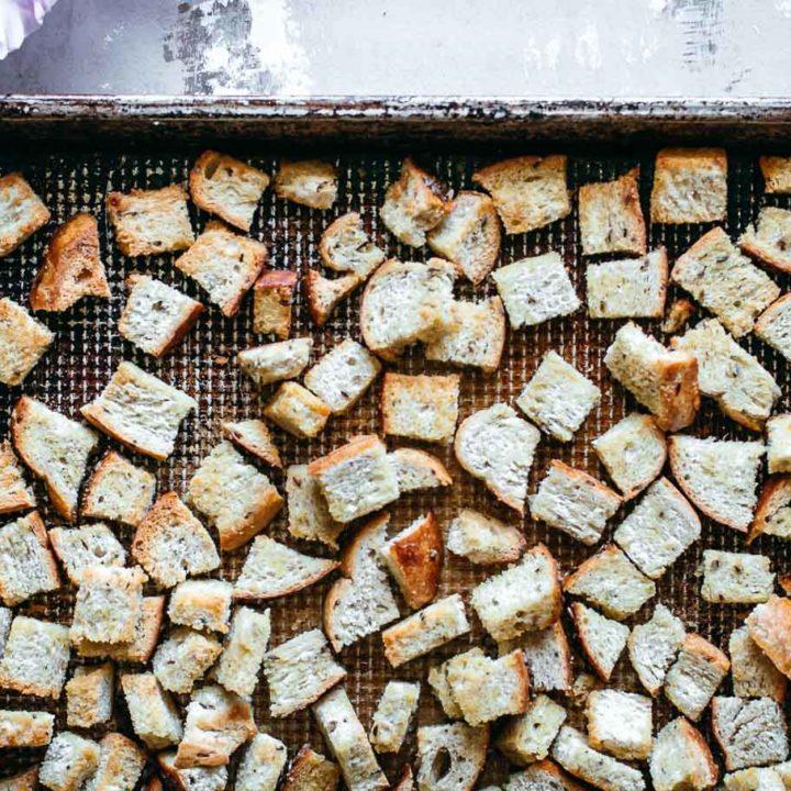 rye bread croutons on a baking sheet
