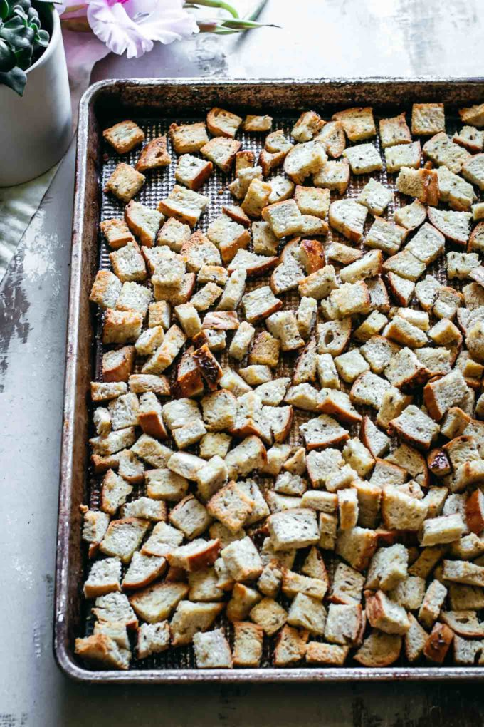 roasted rye bread croutons on a roasting pan