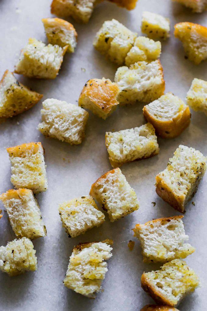 crispy sourdough croutons on a white marble countertop