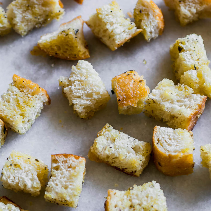 baked sourdough croutons on a white counter