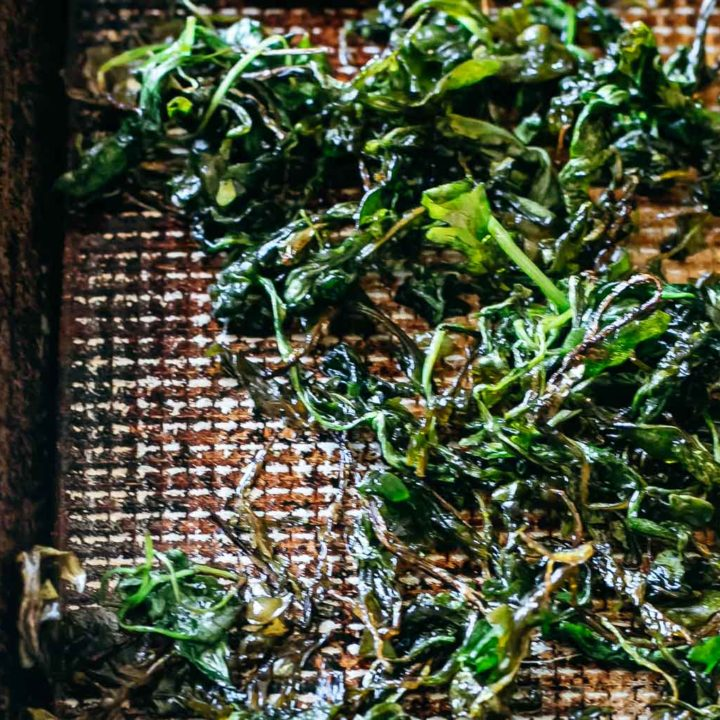 crispy roasted arugula on a baking sheet