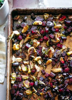 roasted beets and brussels sprouts on a baking sheet