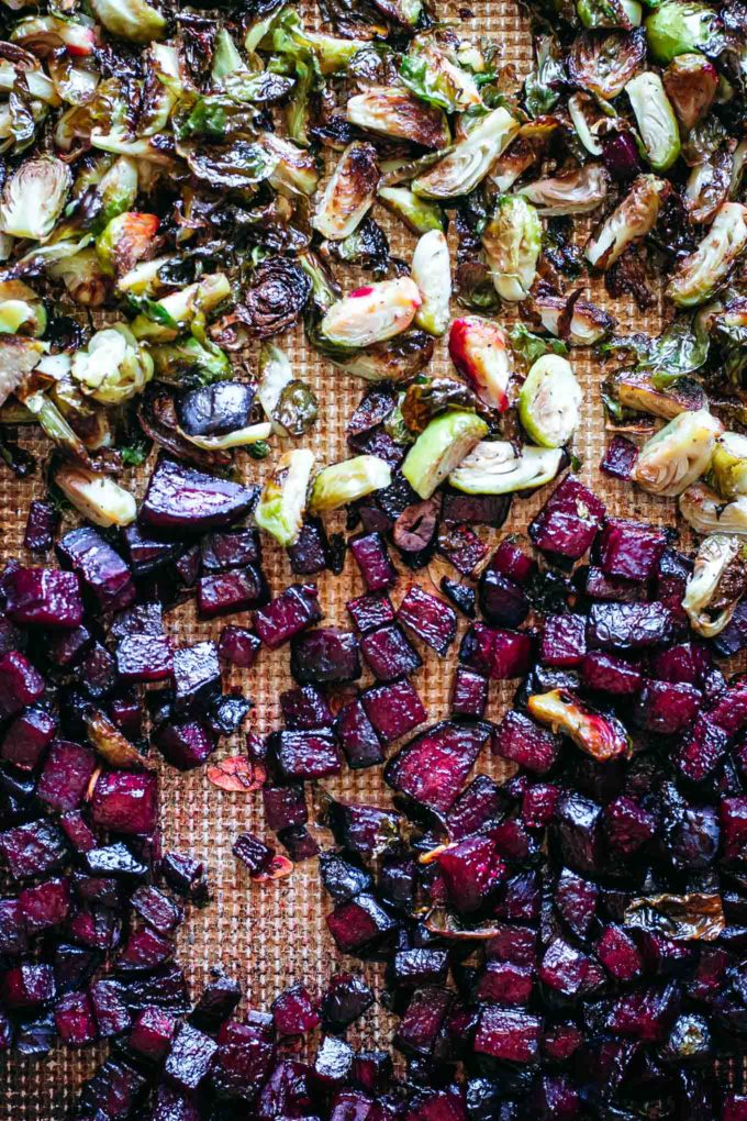 baked brussels sprouts and beets on a pan