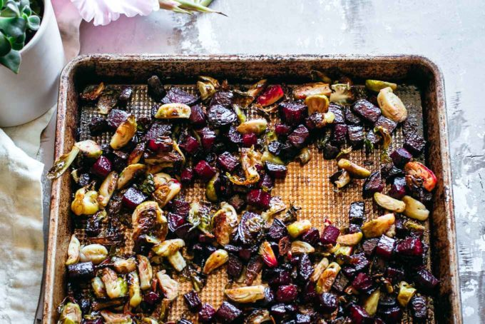 baked beets and brussels sprouts on a roasting pan