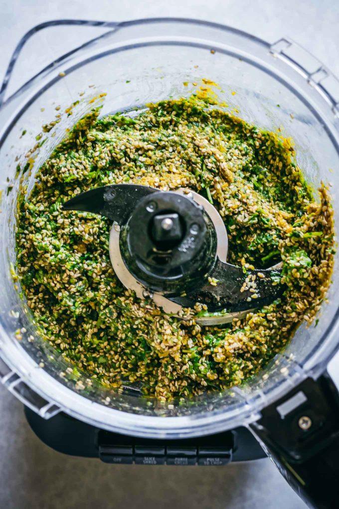 blended sesame pesto inside of a food processor