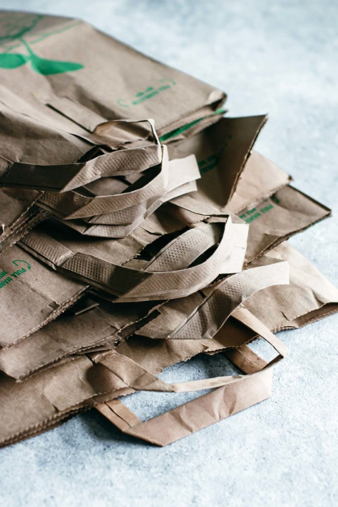 stack of paper grocery bags on a countertop