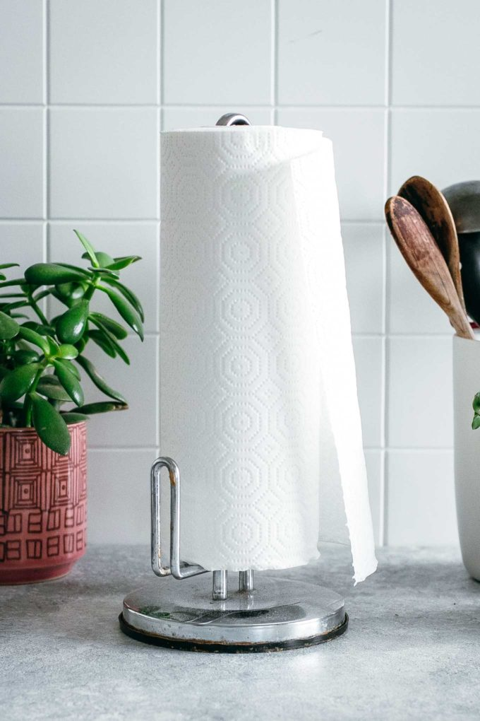paper towels on a paper towel holder on a kitchen counter