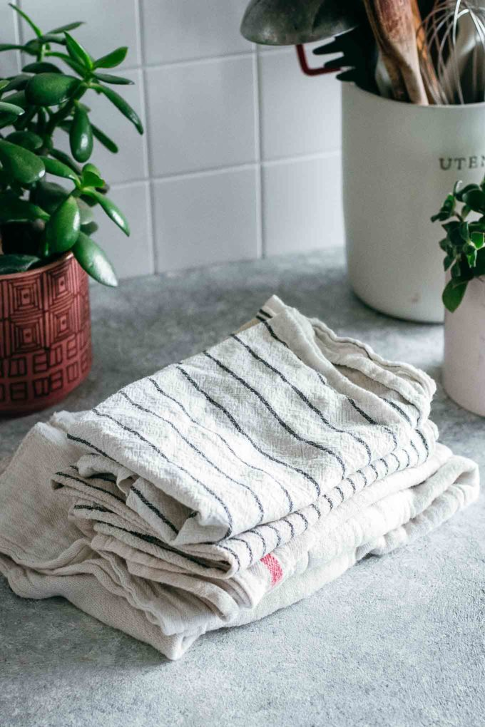 stack of folded cloths on a countertop