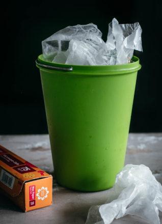 crumpled wax paper in a compost bin