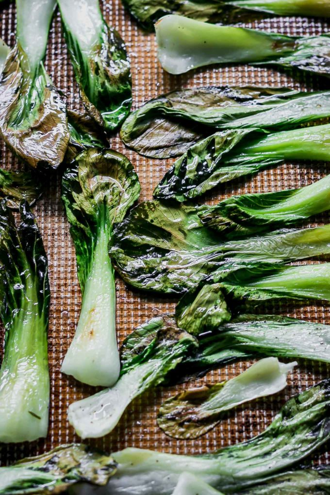 oven baked bok choy on a roasting pan