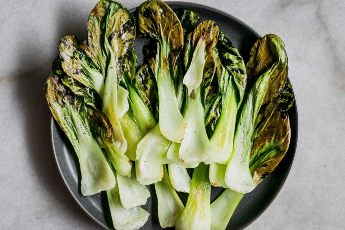 bok choy chips on a blue plate
