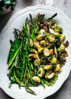 roasted brussels sprouts and asparagus in a serving dish