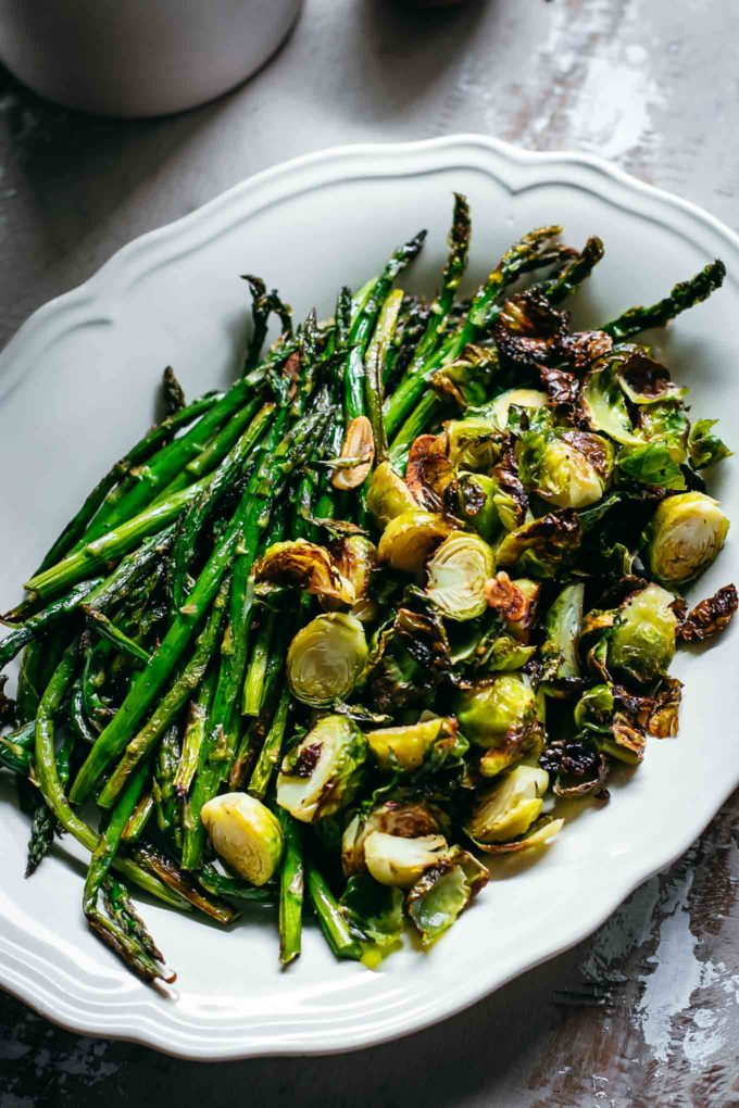 close up of oven baked brussels sprouts and asparagus