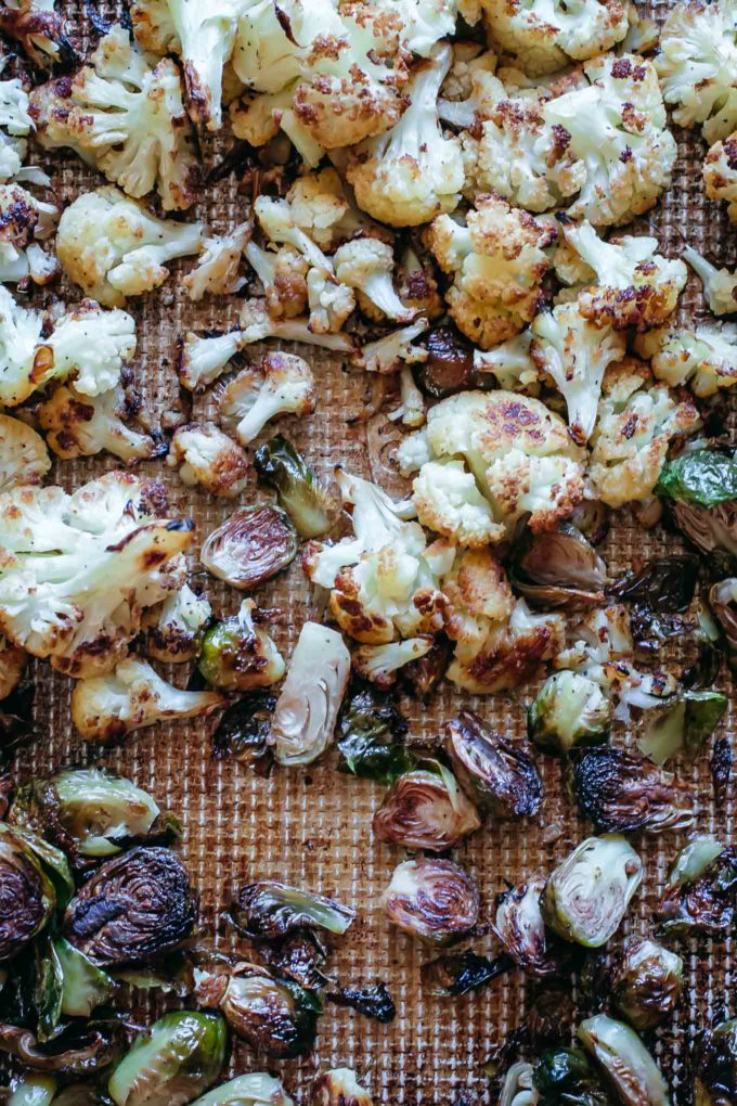baked cauliflower and brussels sprouts on a baking sheet