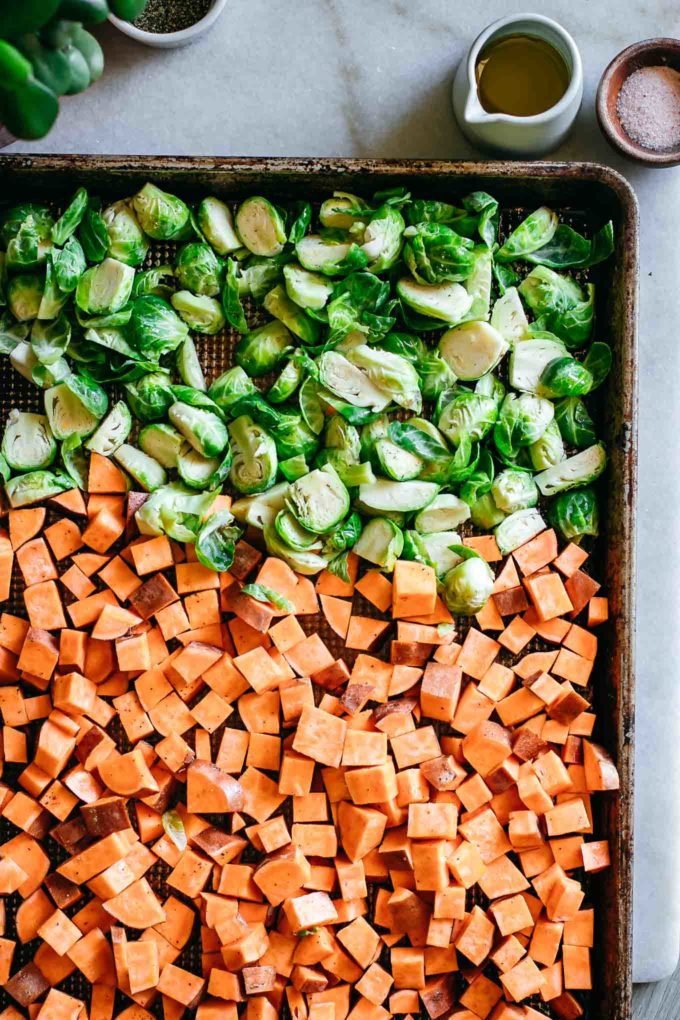 chopped raw vegetables arranged on a baking sheet