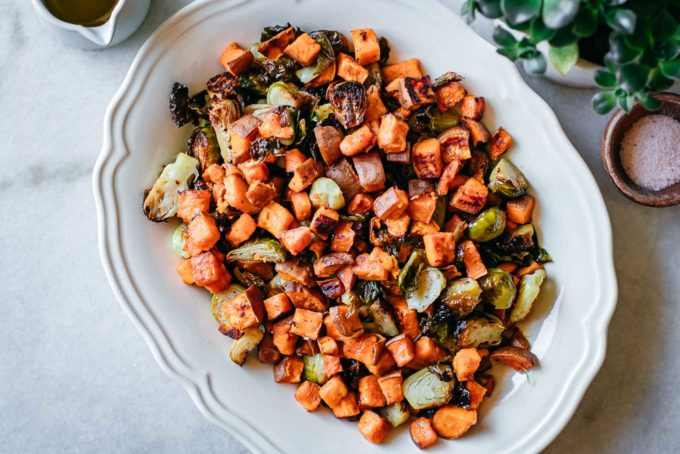 roasted brussels sprouts and sweet potatoes on a platter