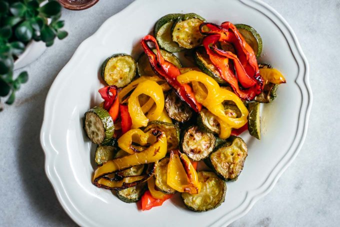 roasted zucchini and bell peppers on a white plate