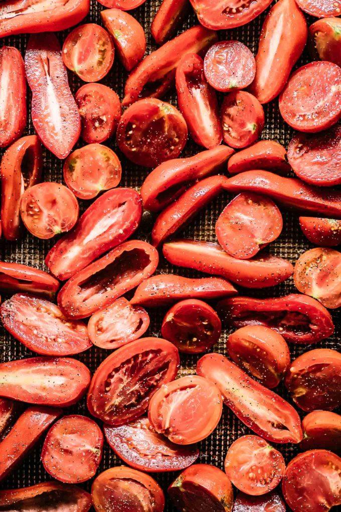cut tomatoes on a sheet pan
